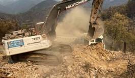 Alanya'da kül olan evlerin yıkımına başlandı